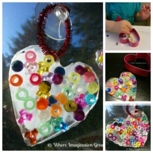 Easy Valentine's Day craft for kids! Make this heart suncatcher craft with just glue and beads! Perfect Valentine's art project for both toddlers and preschoolers!